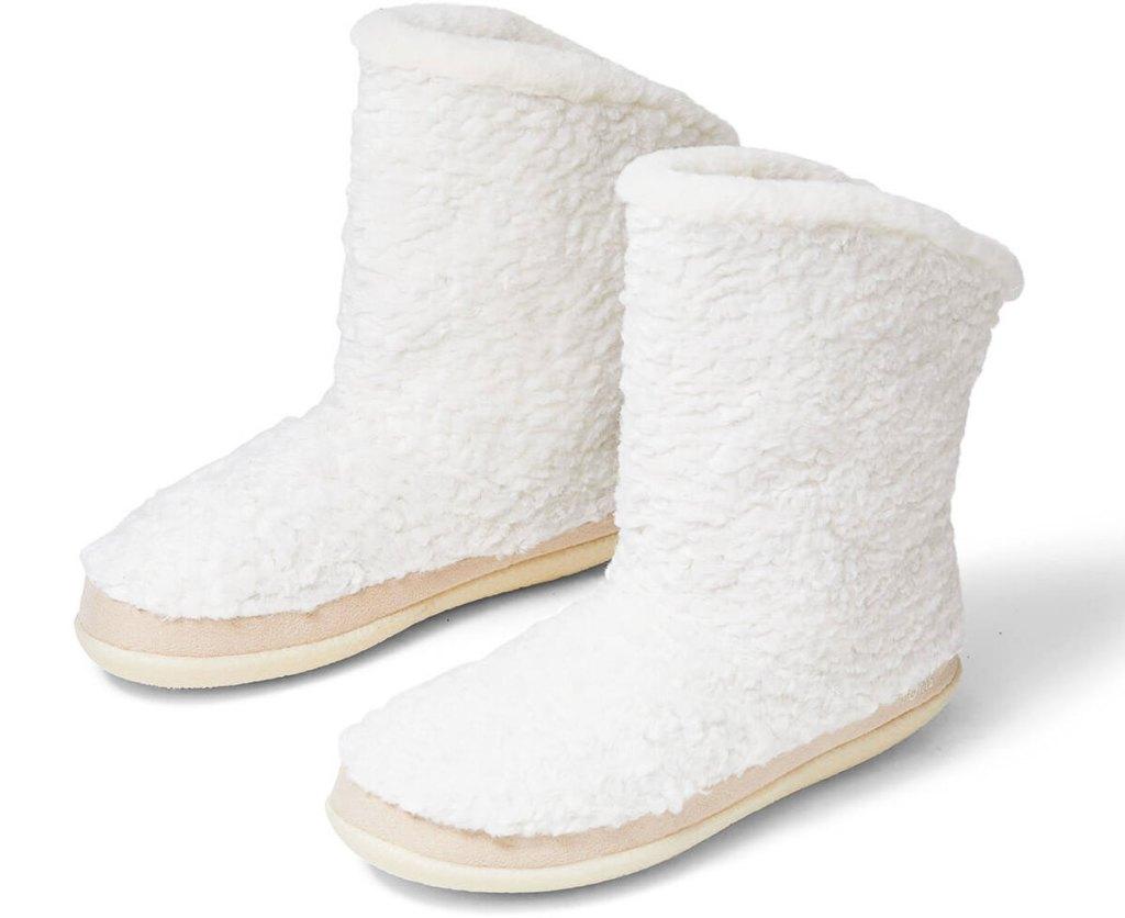 pair of white plush fuzzy slipper boots