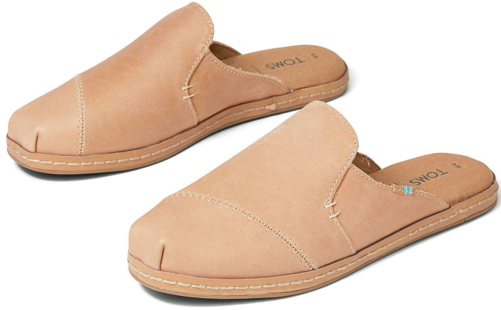 pair of taupe colored leather slip-on mules