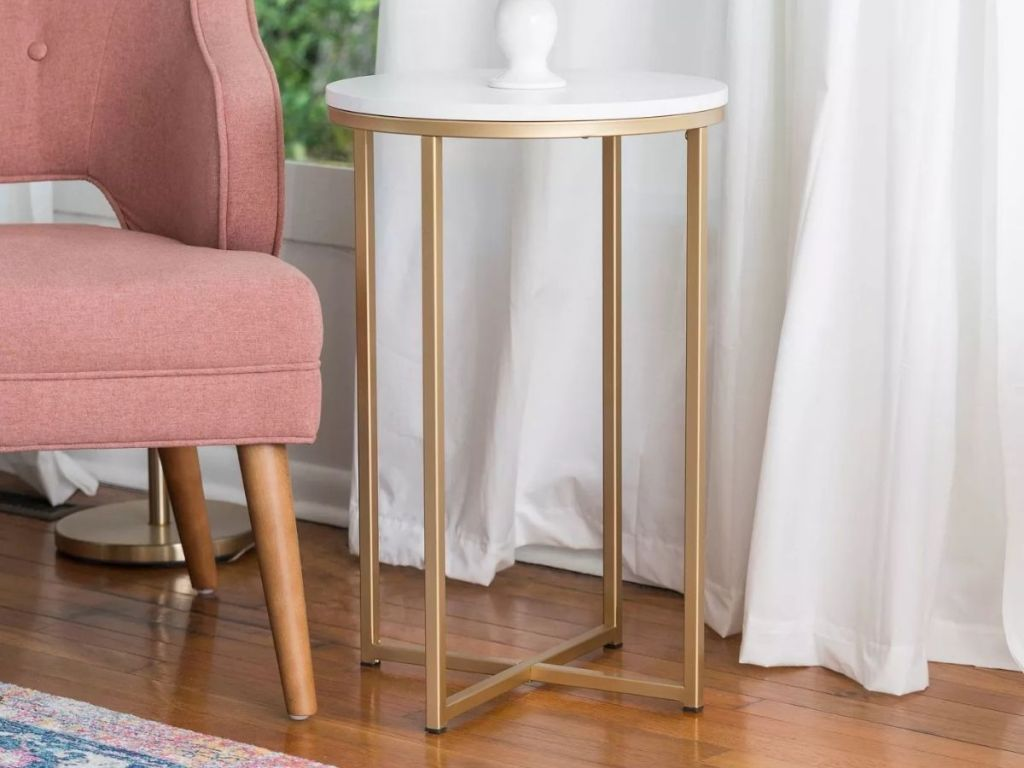 Target Brass Side Table next to pink chair