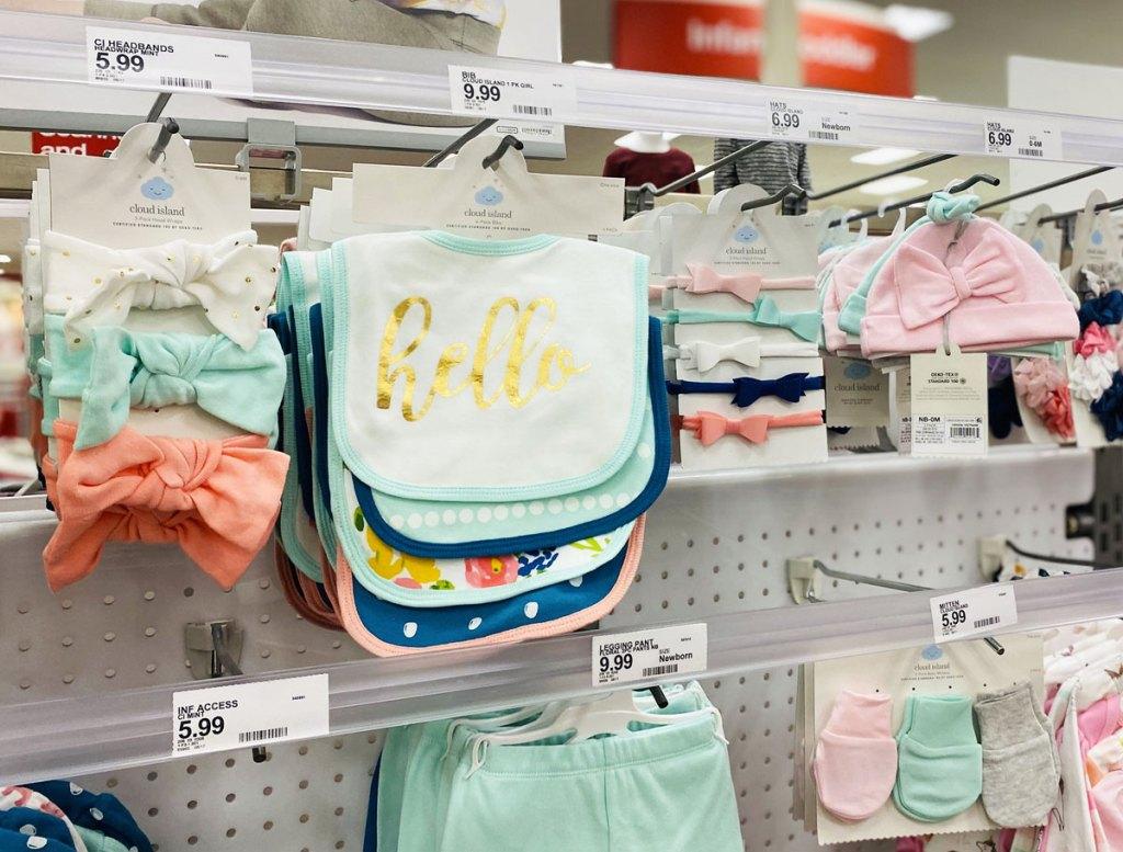 cloud island brand newborn accessories on display rack at target