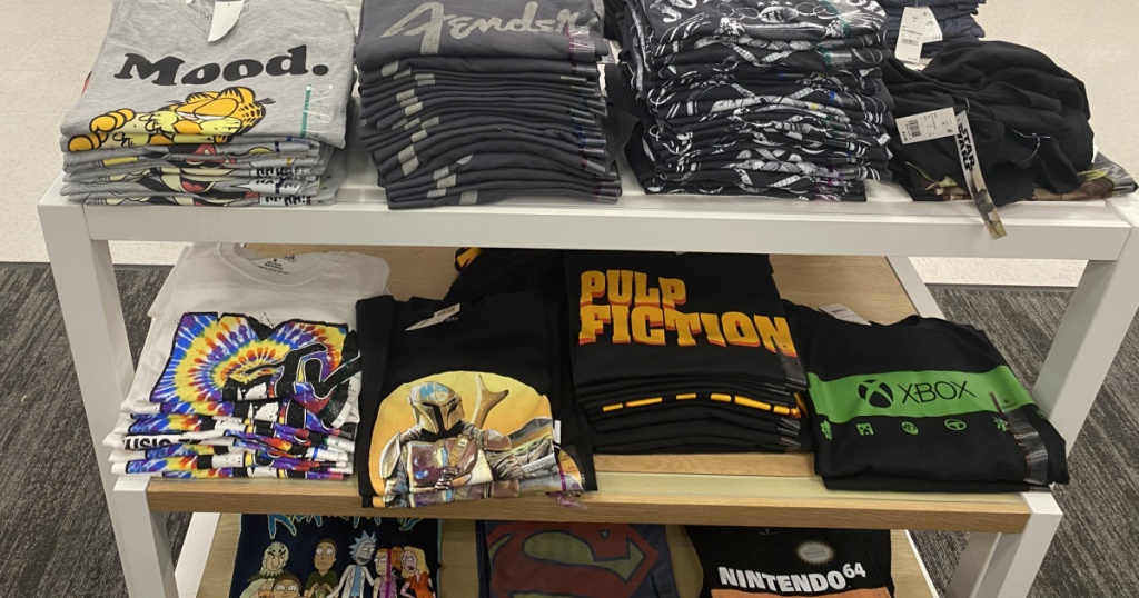 men's graphic tees folded on display table in store