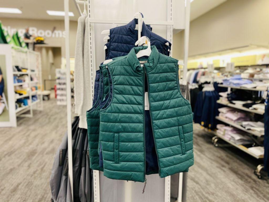 Target Men's Puffer Vests on hangers at Target
