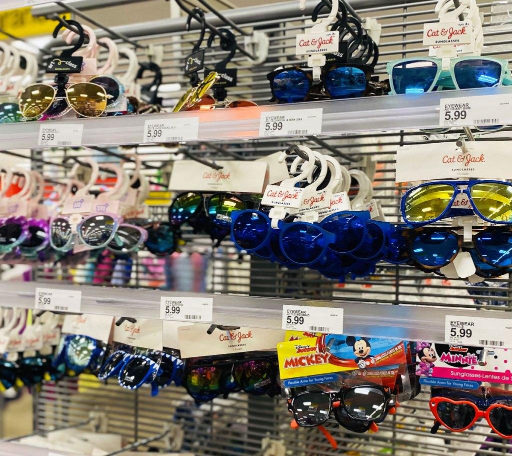 display rack full of various pairs of kids sunglasses at target