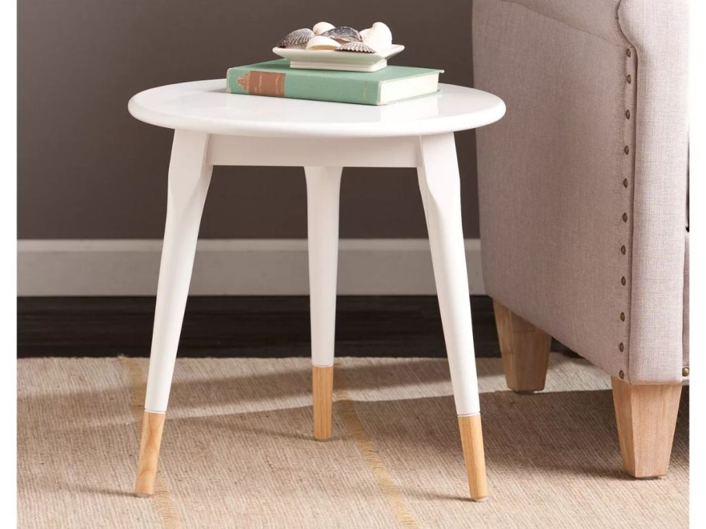 Target White Side Table next to tan couch