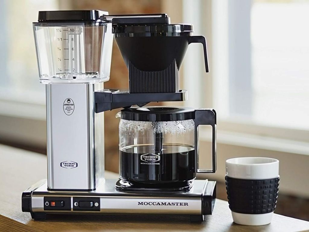 Technivorm Moccamaster 59691 on counter with cup