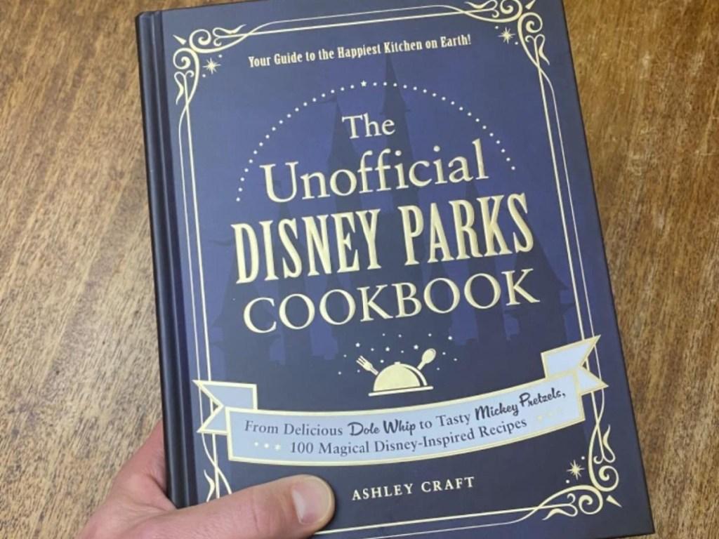 hand holding Disney Parks cookbook