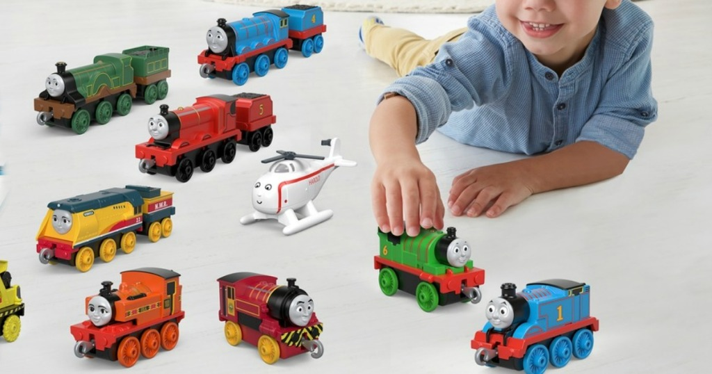 boy playing with Thomas Trains