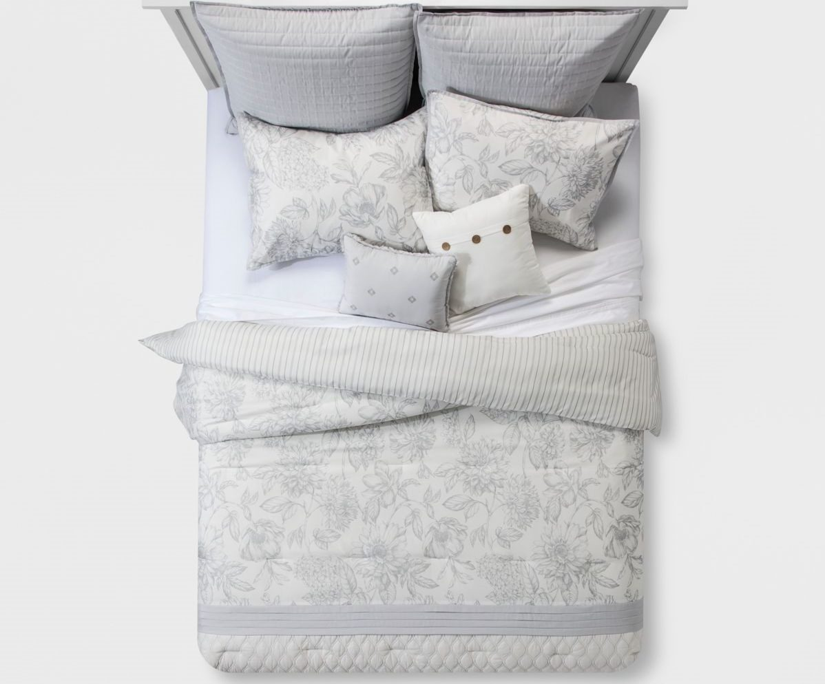 bed with comforter and pillows on it