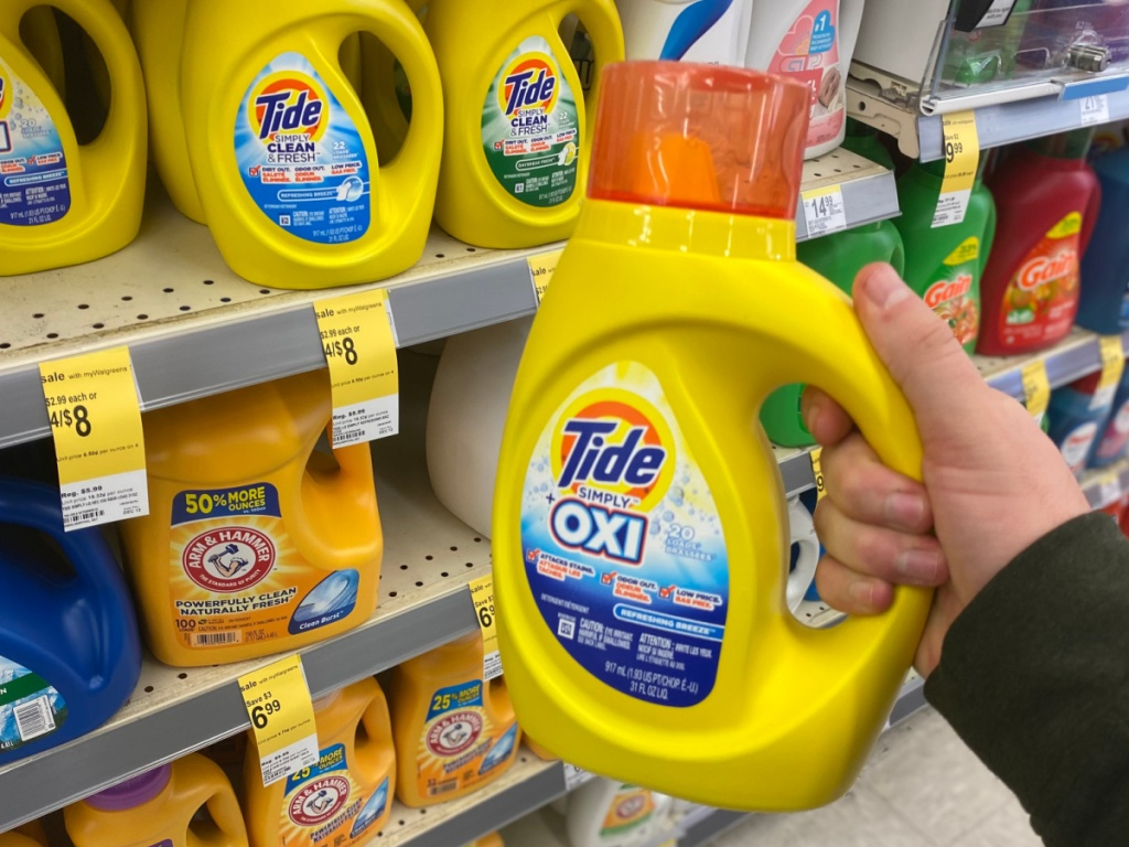 hand holding tide simply detergent in walgreens