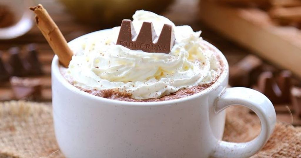Toblerone mini chocolate bar ina cupe of hot chocolate with whipped cream