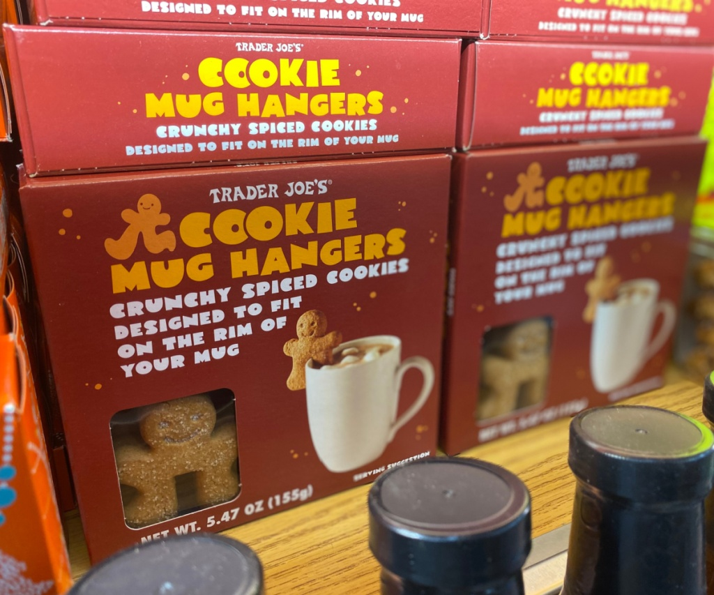 boxes of cookie mug hangers stacked on store shelf