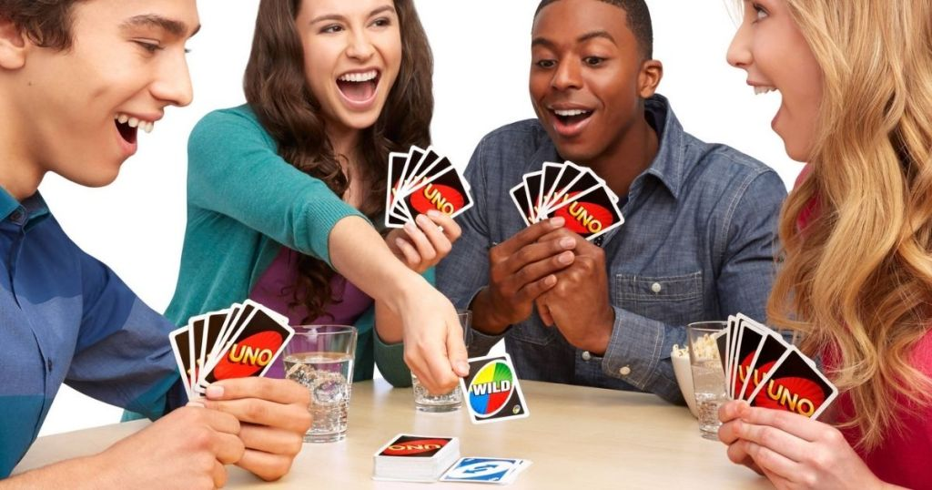 four people playing UNO card game