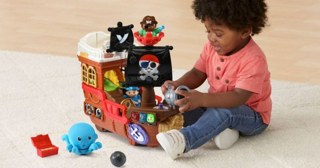 boy playing with VTech Pirate Ship