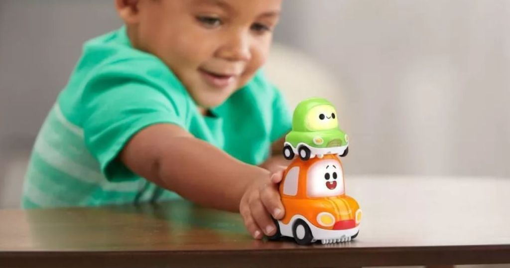 boy pushing VTech SmartPoint Vehicles
