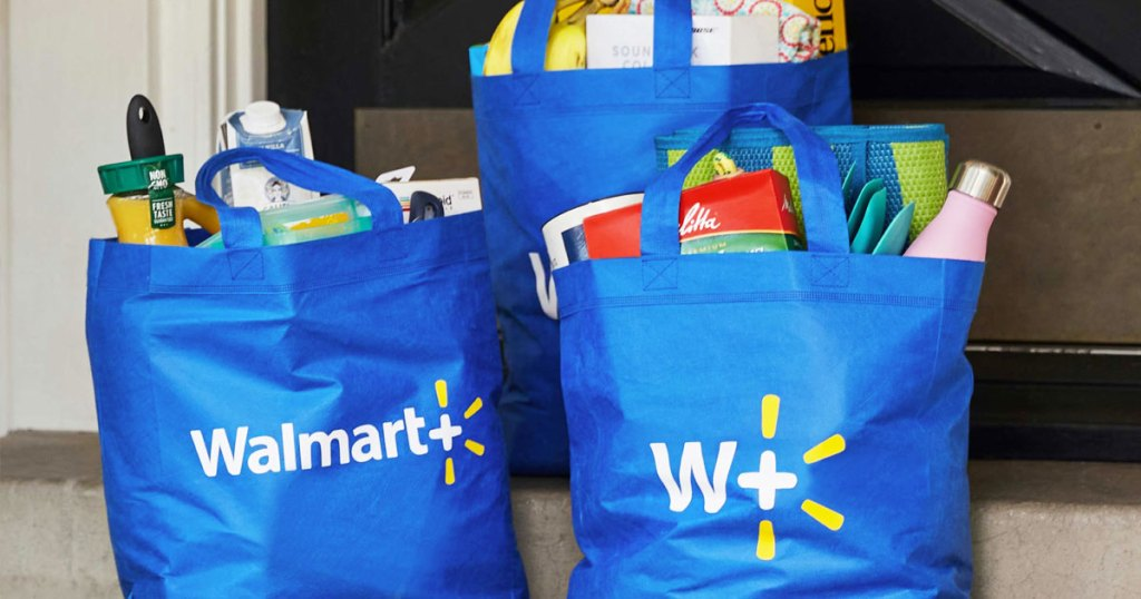 blue walmart+ reusable shopping bags filled with groceries sitting on steps at front door