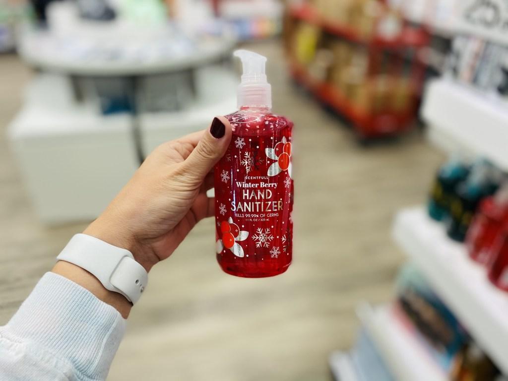hand holding Winterberry Hand Sanitizer