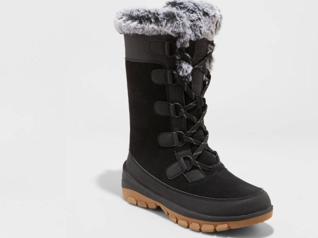 black boots with brown soles and gray fur