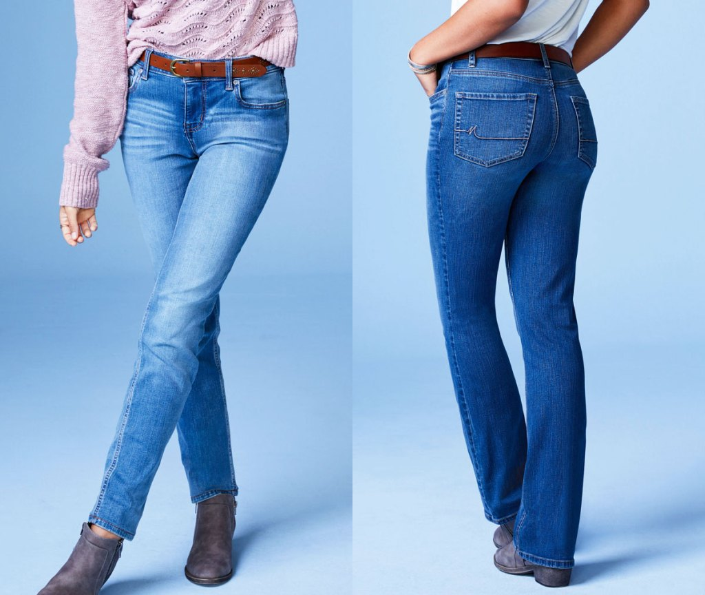 two women modeling jeans in light and dark washes