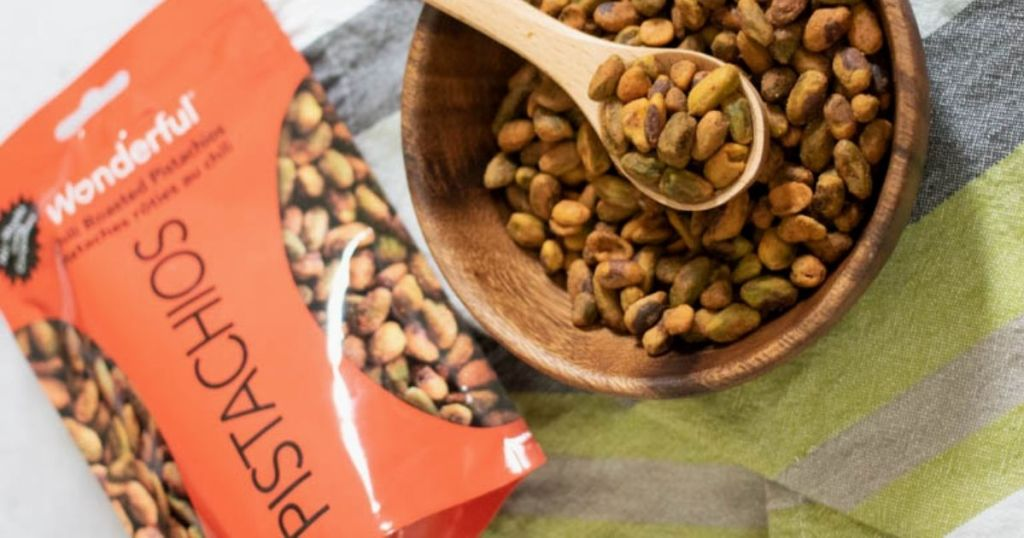 Wonderful Pistachios Chili Roasted Pouch with bowl of nuts