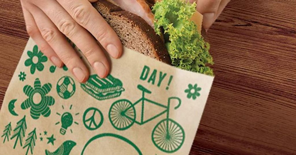 hand adding sandwich to Ziplock Recyclable Paper Sandwich Bags