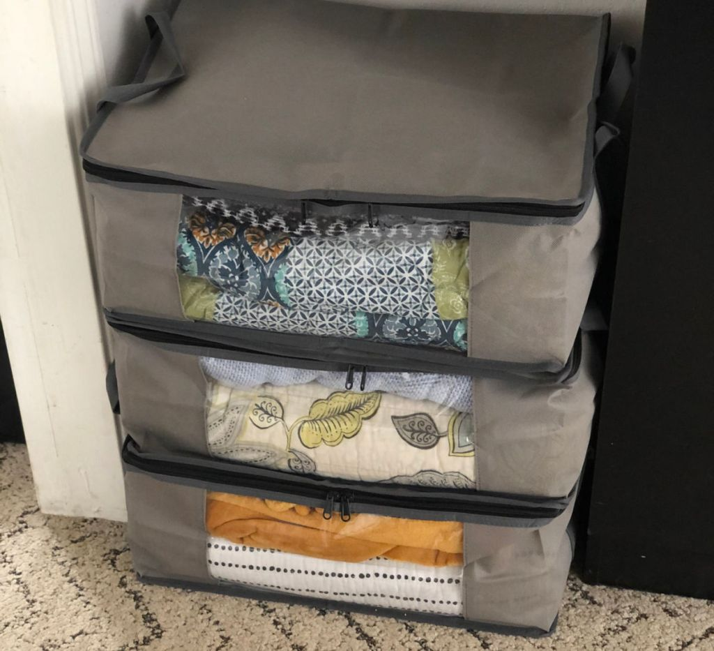 3 sweater bags stacked vertically
