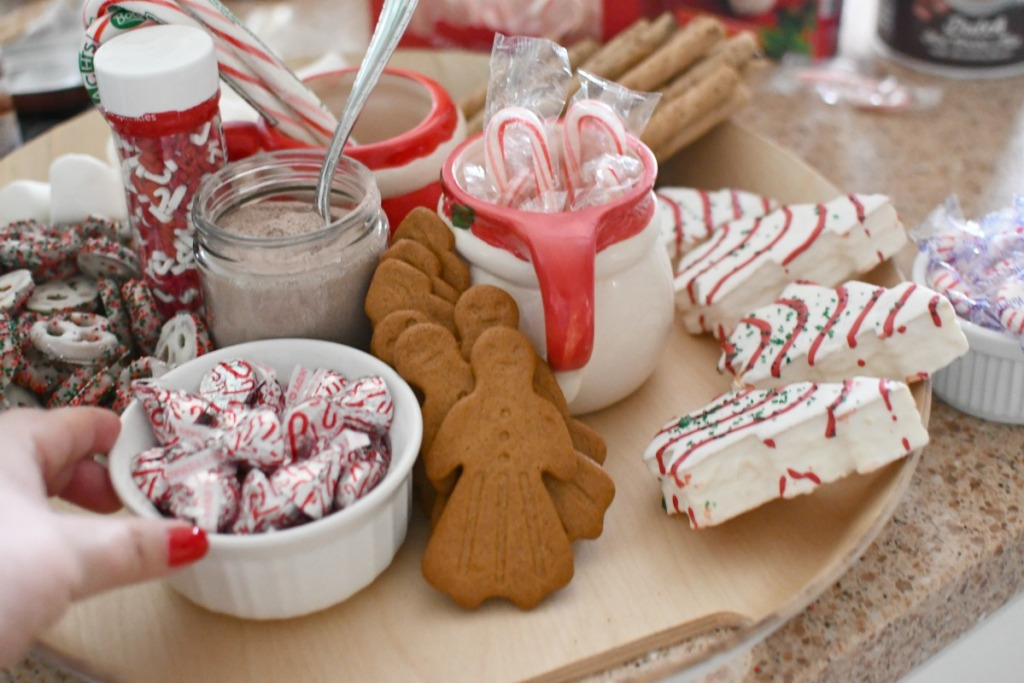 adding candy to hot cocoa charcuterie