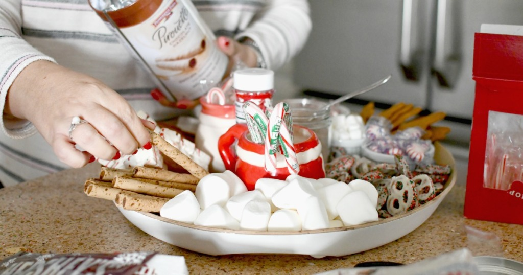 adding cookies to hot cocoa charcuterie