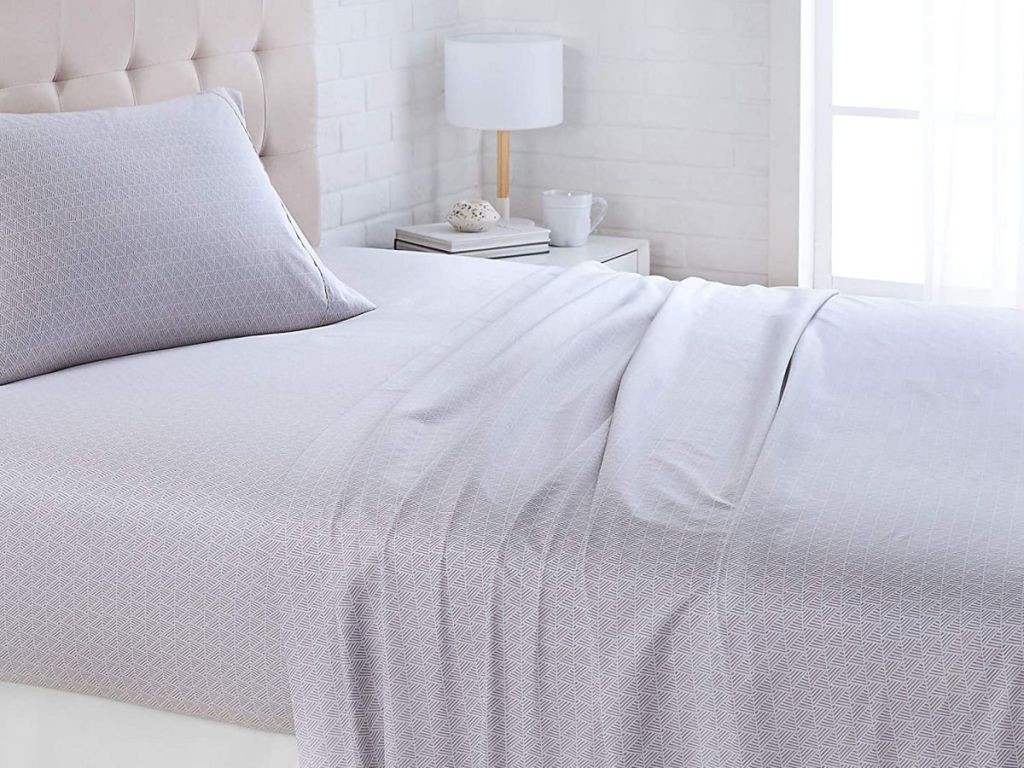 gray sheets on bed