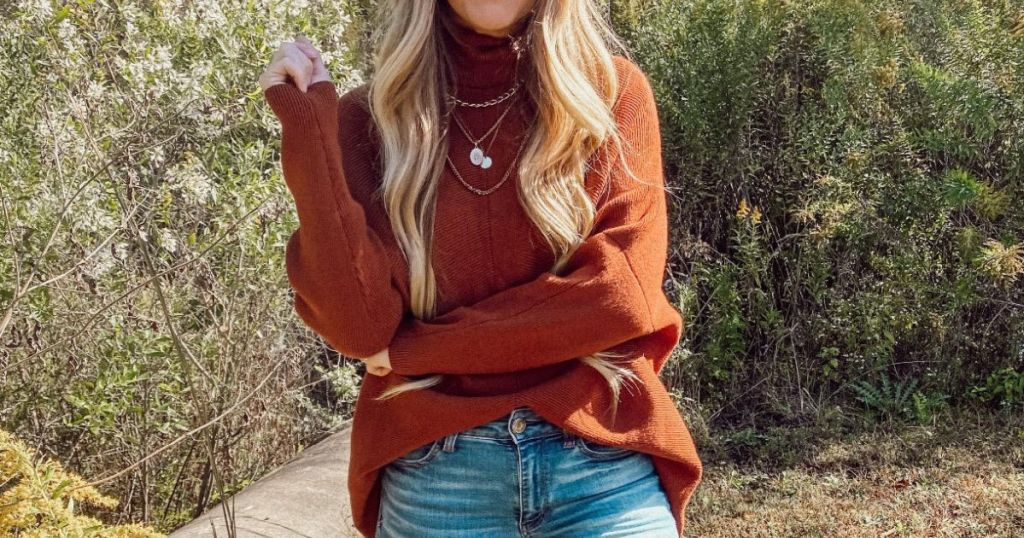woman wearing rust-colored sweater outside