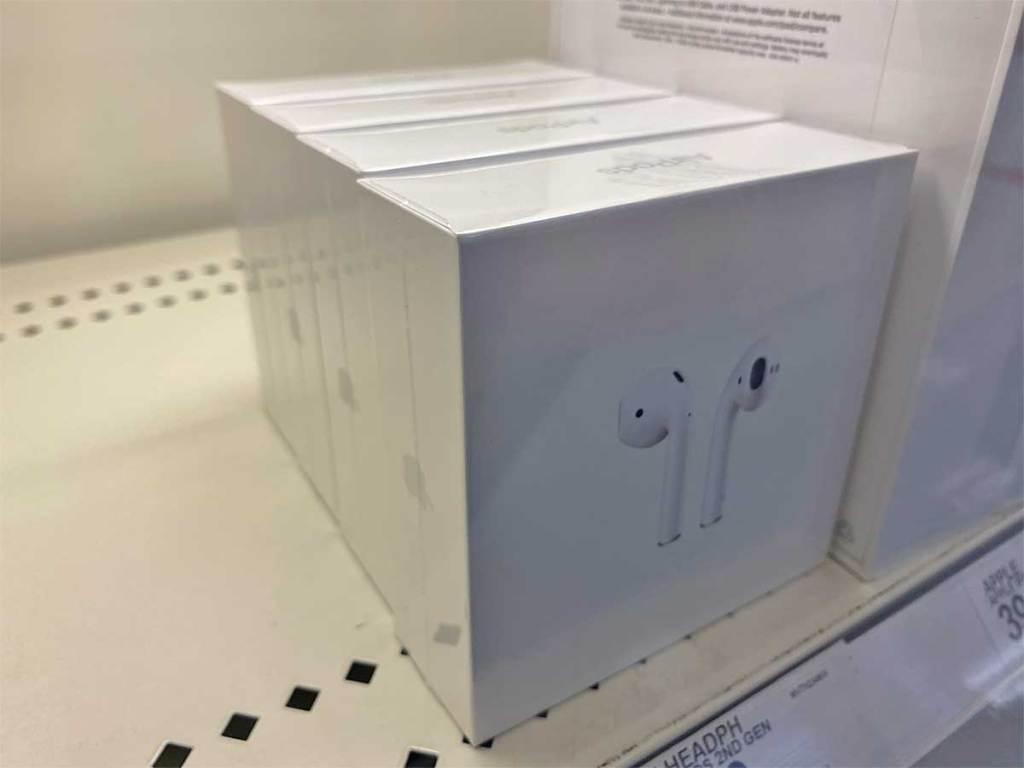 air pods in a box on a shelf