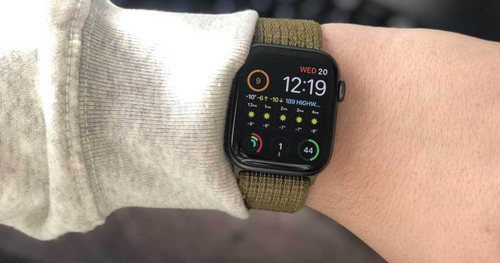 man holding up wrist with apple watch band