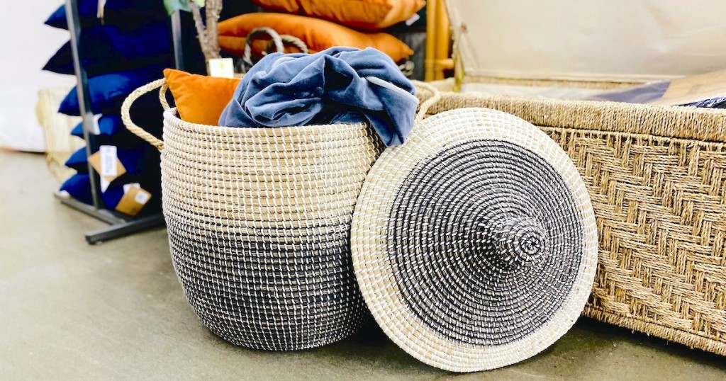 blue and white ombre basket sitting on store floor