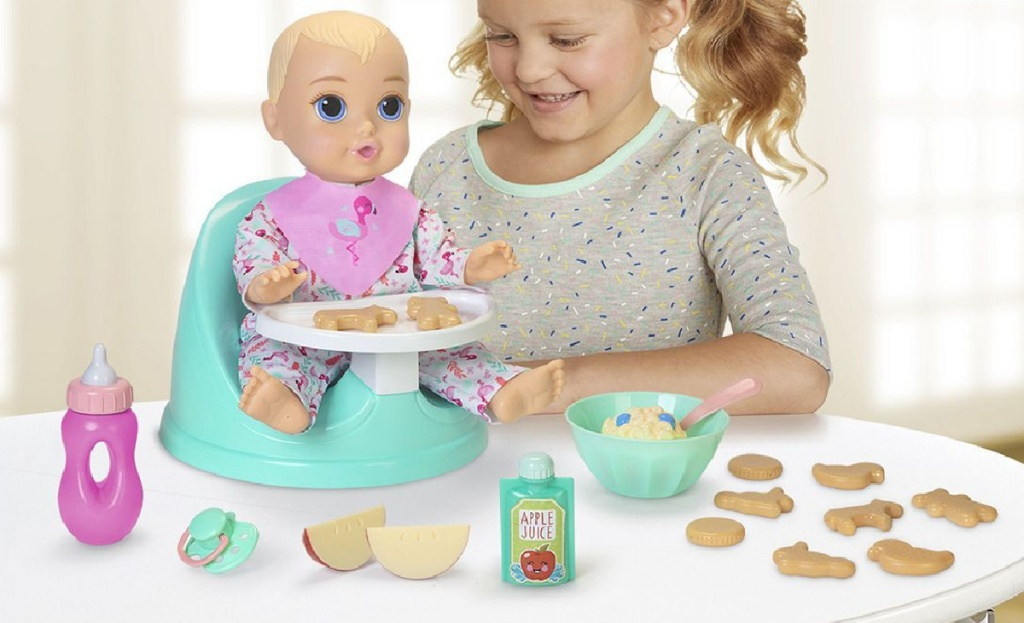 little girl playing with be my baby doll set