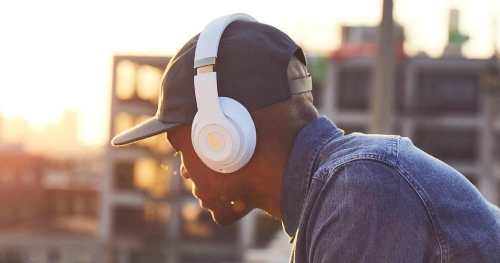 beats studio3 headphones on guy on rooftop