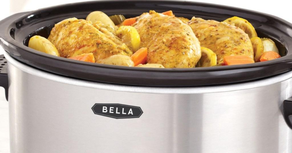 bella crok pot with stew in it