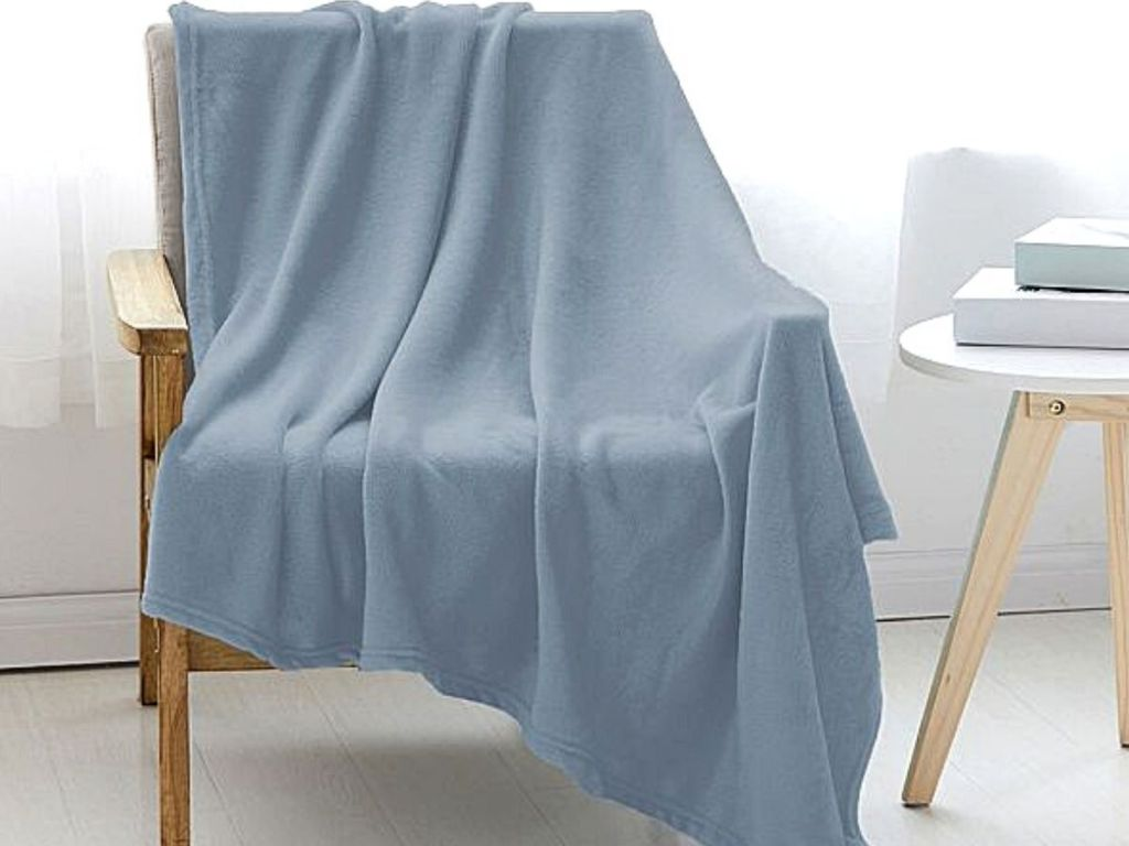 blue blanket thrown over chair