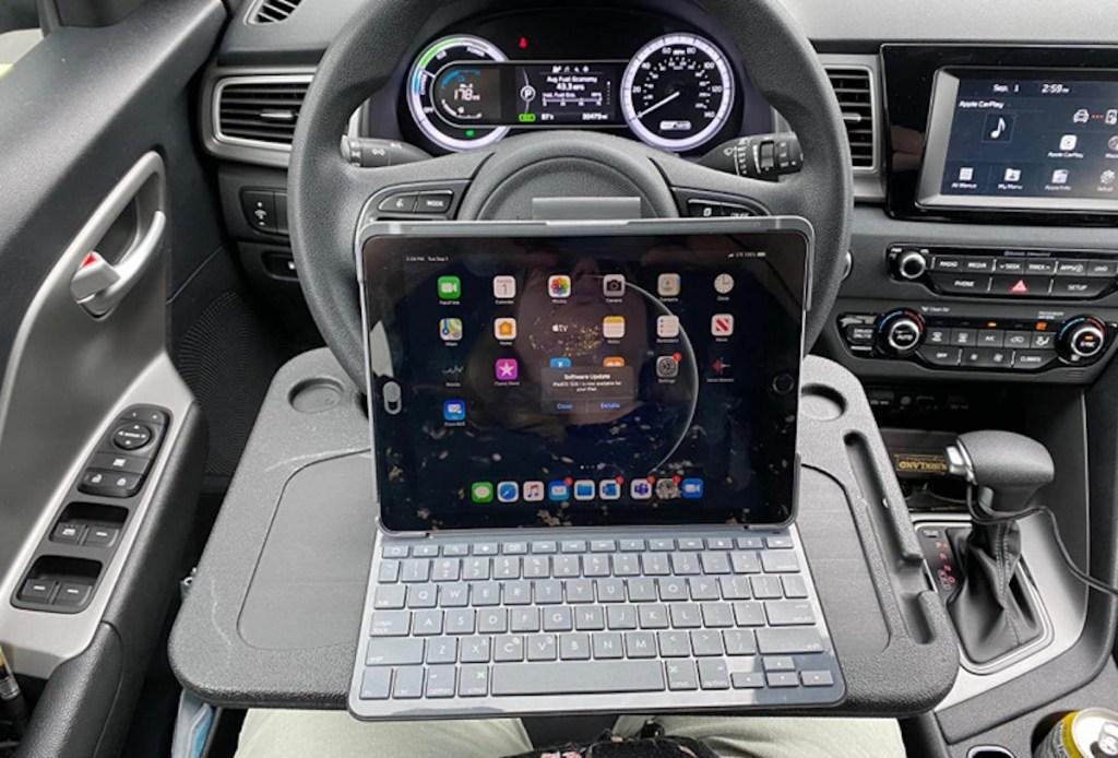 laptop on top of desk car steering wheel