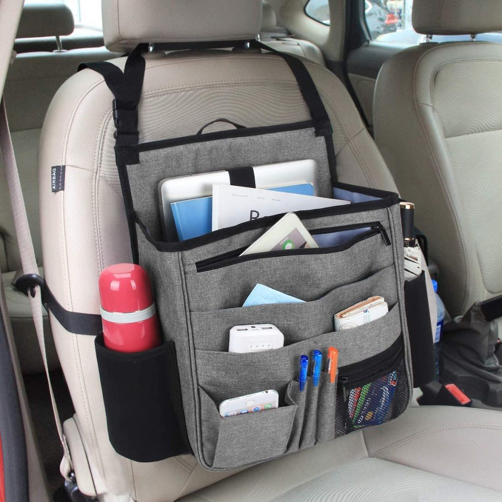 front seat of car with organizer stocked with water bottle pens and paperwork