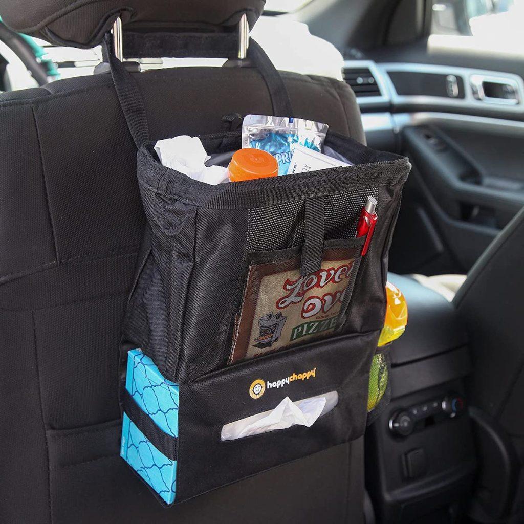 black mesh trash can hanging on black car seat