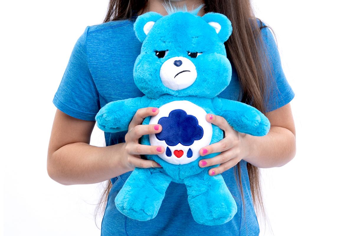 care bears grumpy bear in girls hand