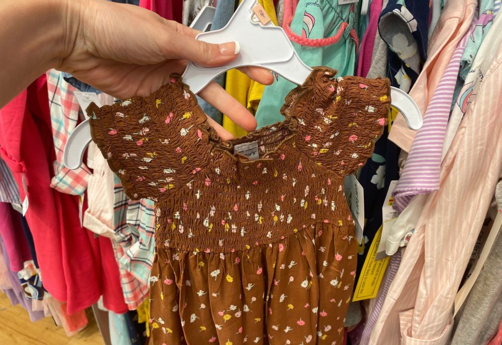 carters toddler dresses in store on hanger