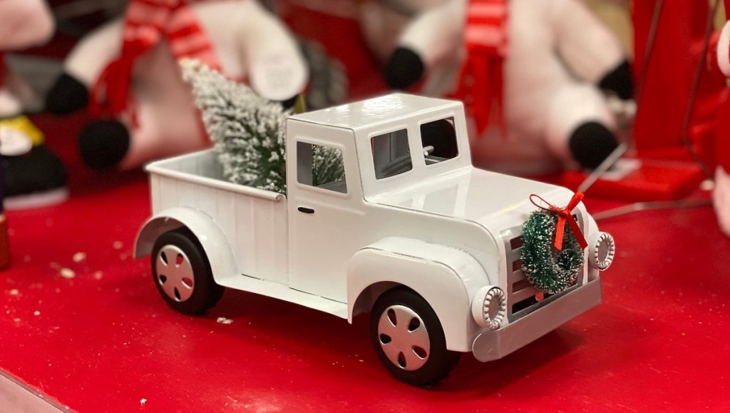 white decorated truck on red target christmas decoration store shelf