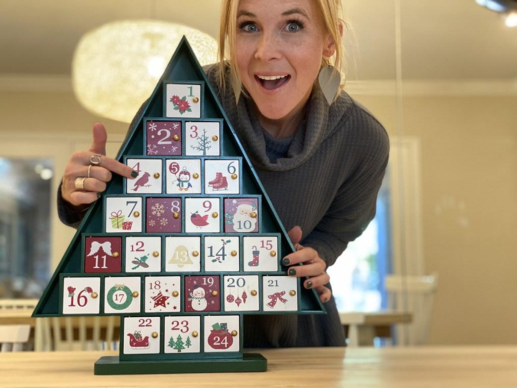 woman with christmas tree advent calendar