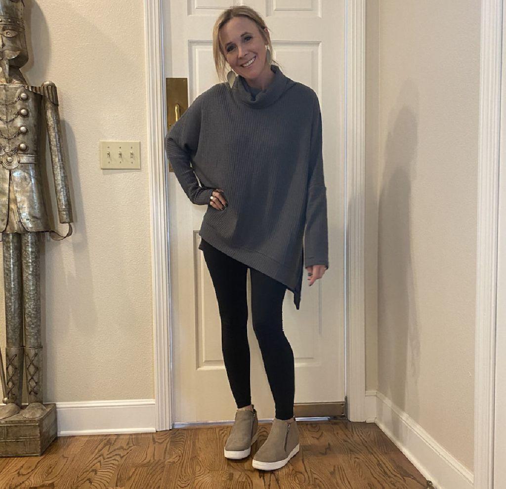 woman wearing leggings and sweater