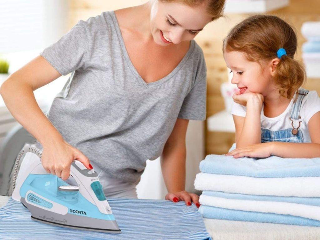 woman using iron on fabric