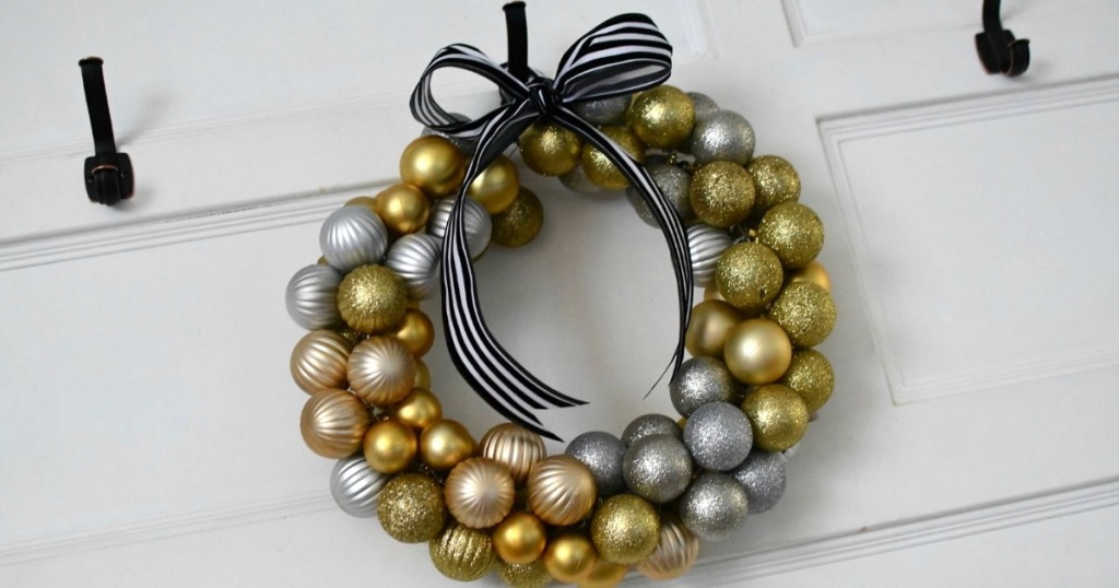 Christmas wreath with gold ornaments hanging