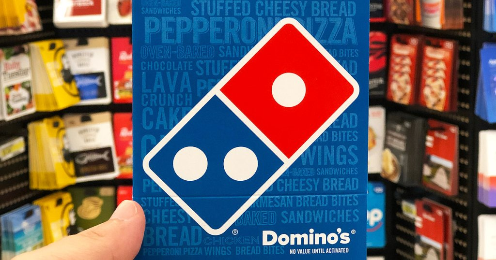 person holding up a blue and red dominos pizza gift card