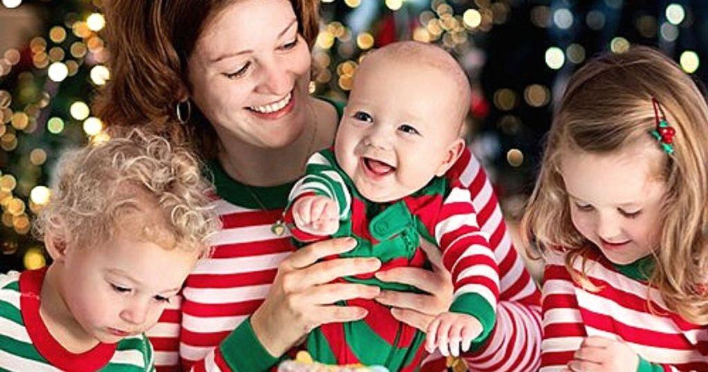 woman and kids wearing matching Christmas pajamas