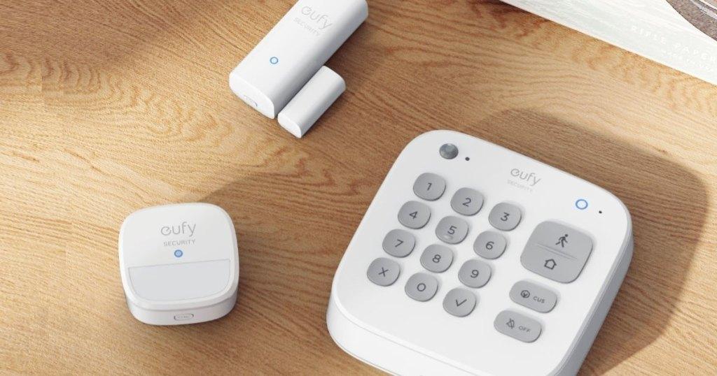 eufy home security keypad, motion sensor, and entry sensor on wood table