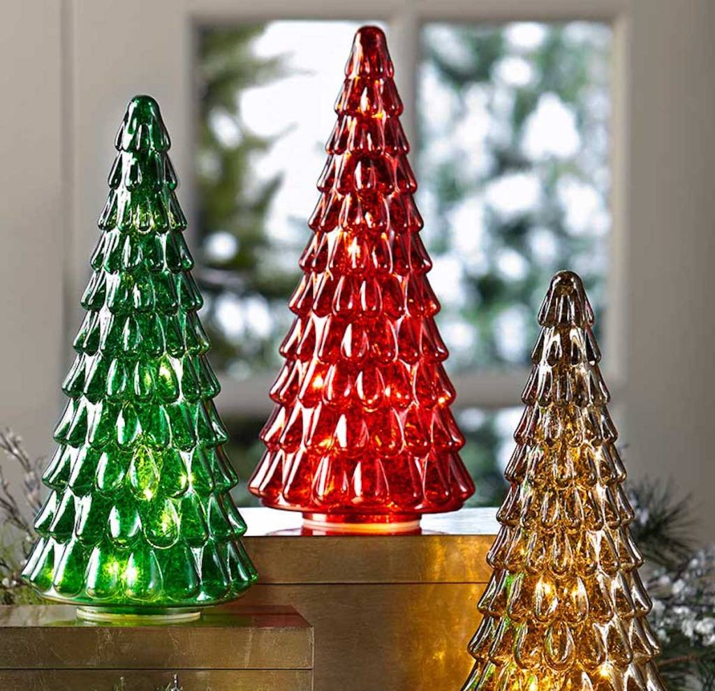 green, red, and gold festive light up trees